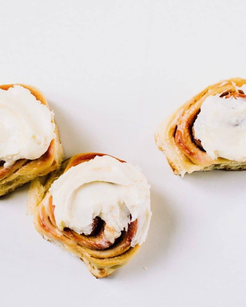 homemade cinnamon buns on white background