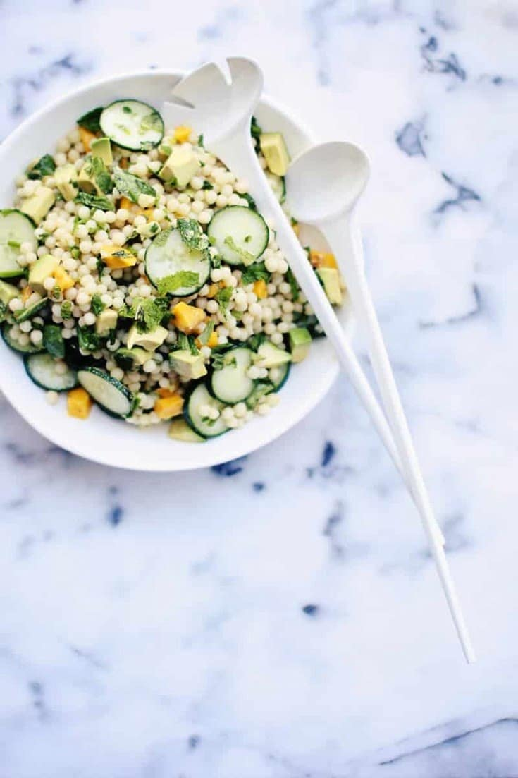 This easy Summer Couscous Salad Recipe is simple, fresh and healthy. Israeli couscous (aka pearl couscous) is tossed with fresh, light ingredients and comes together in minutes. Vegetarian-friendly!