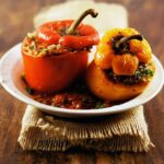 lamb-stuffed peppers in spiced tomato sauce