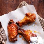 Baked Buffalo Wings with Homemade Blue Cheese Dressing