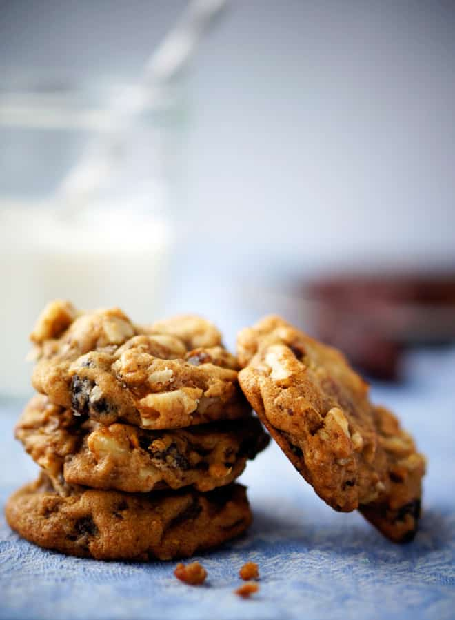 old fashioned hermit cookies in a pile with a few crumbs