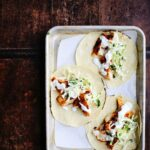Spicy Fish Tacos with Cabbage Slaw + Lime Crema