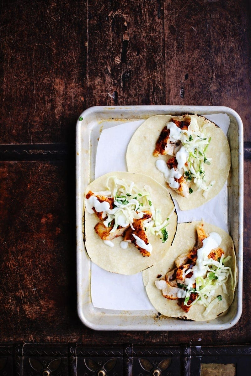 fish tacos with slaw on a tray