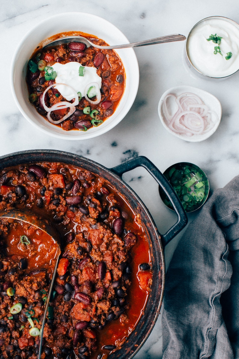 chili with ground beef in a pot and a bowl
