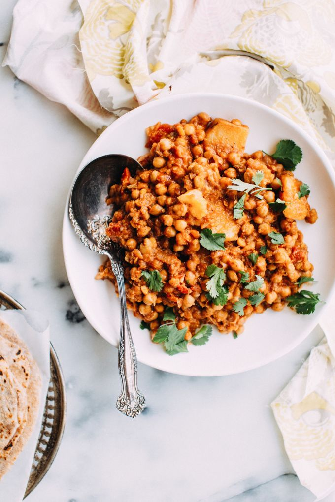 vegan indian chickpea curry on a plate with a spoon