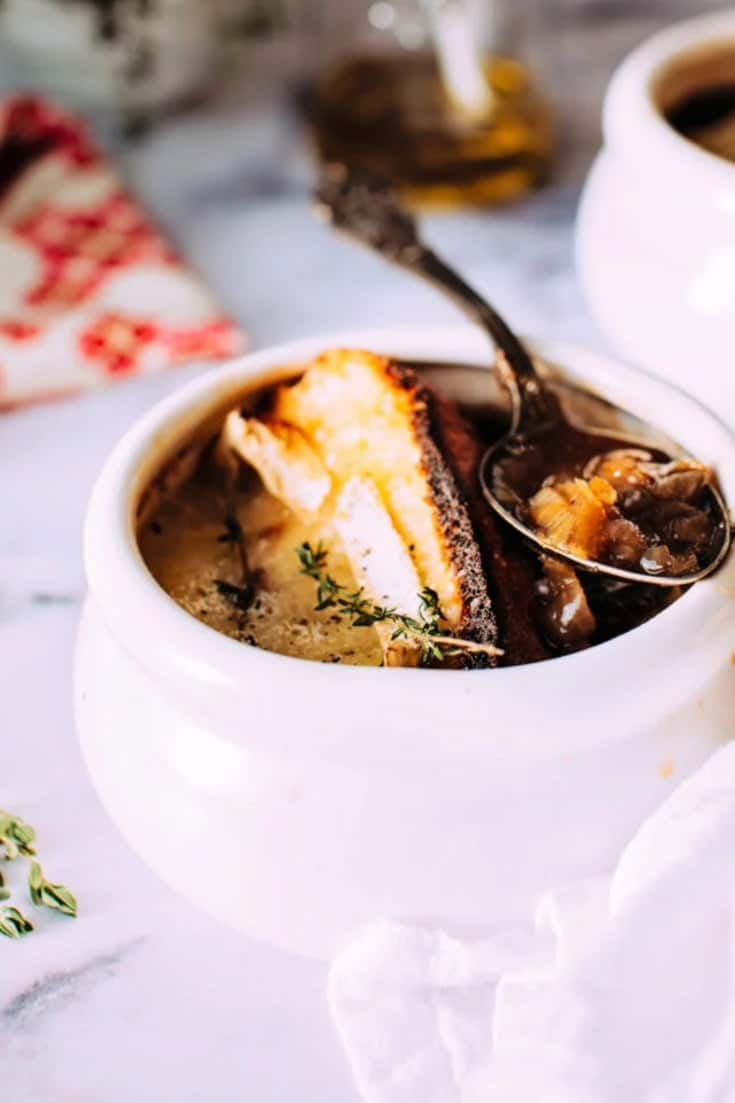 My Classic French Onion Soup Recipe Topped With a Gooey Baked Brie Crouton is the best soup you'll ever have! It's fragrant, quick and easy, cheesy, and oh so comforting! Use some beef stock and toss your ingredients into a slow cooker, its that simple!
