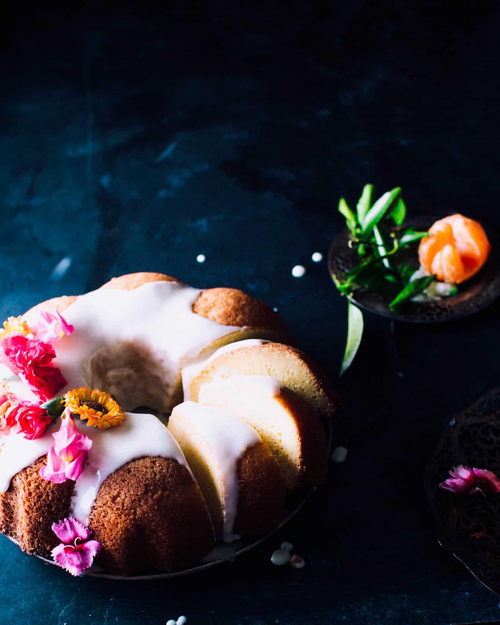 orange pound cake with orange icing and flowers