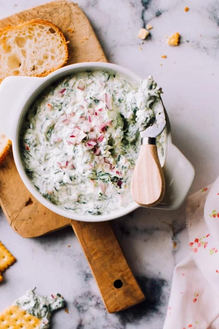 This spinach dip recipe is so easy, it'll be whipped up before you know it! This creamy, classic, cheesy dip is made from a mix of cream cheese and sour cream and uses real spinach instead of soup mix.