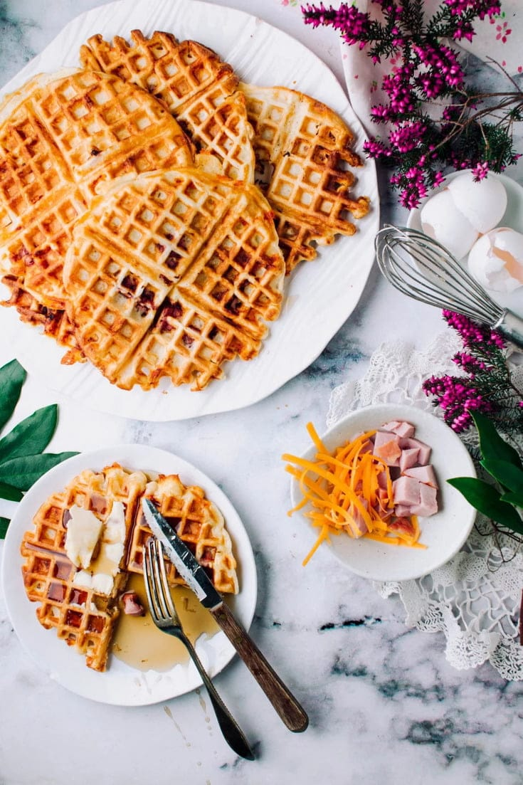 Breakfast/Brunch just got even better with these Easy, Fun, and Homemade Ham and Cheese Buttermilk Waffles. Deliciously crispy, tender waffles recipe with ham and cheddar cheese. With maple syrup pools in every pocket, they're the perfect sweet-savoury combo.