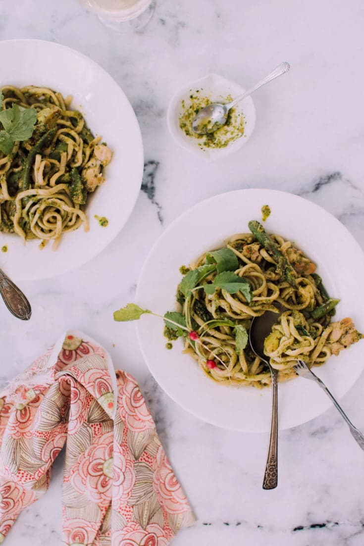 A quick and easy Chicken Fettucine with Homemade Chard-Almond Pesto that is deliciously creamy and by far the best pasta dish you will ever have! Make it today. The recipe is just one click away!