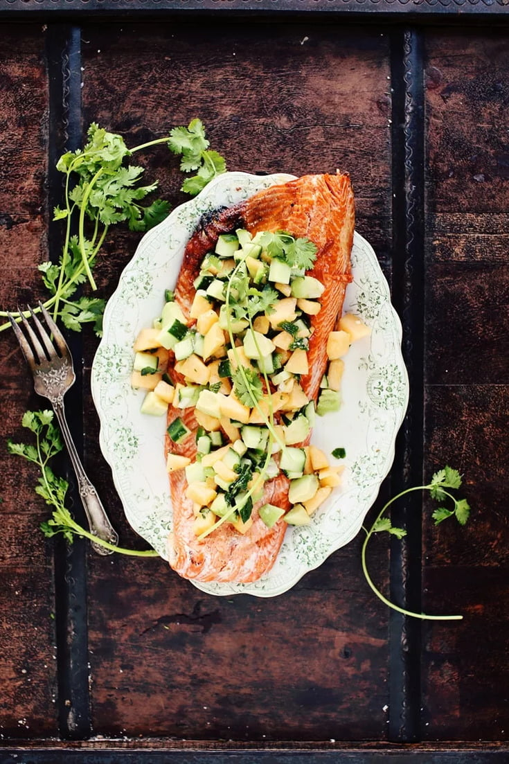 Here's an easy, healthy, and very tasty Grilled Salmon recipe with a summery and creamy Avocado-Melon Salsa that will blow you away! You're one click away from getting this simple, perfect weeknight meal to make when you're cooking light at home!