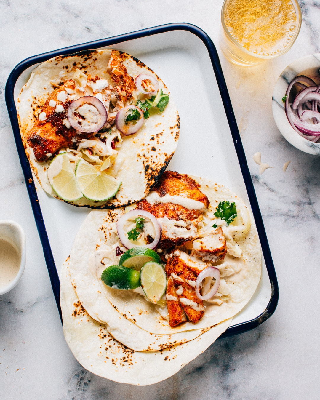 Spicy Fish Tacos with Lime Crema | Foodess